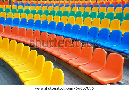 Rows of an empty colourful plastic seats - stock photo