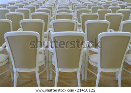 Rows of armchairs.