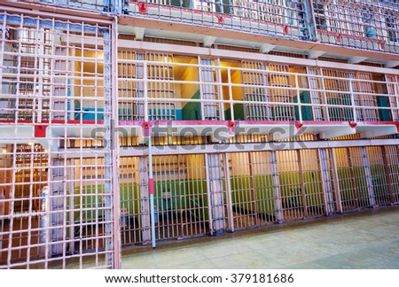 Rows of bars and prison cells - stock photo