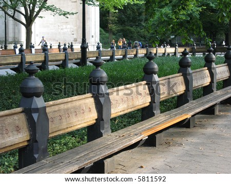 Rows of benches in Central-park - stock photo