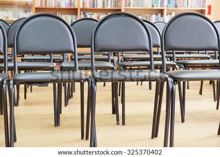 Rows of black chairs in the hall