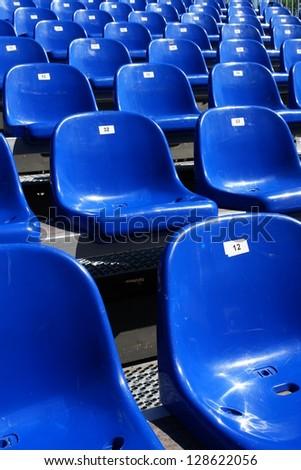 Rows of blue seats on modern stadium - stock photo