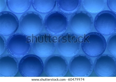 Rows of bottle lids making a pattern background