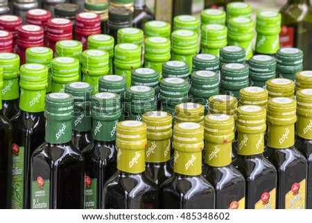 Rows of bottles in different colors