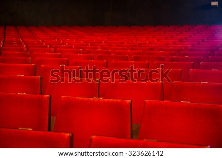 Rows of chairs in old style cinema hall