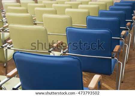 Rows of chairs, standing diagonally.