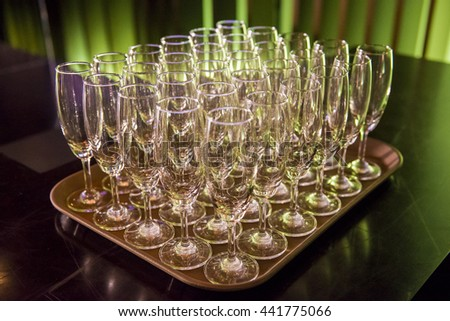 Rows of champagne glasses in wedding party - stock photo