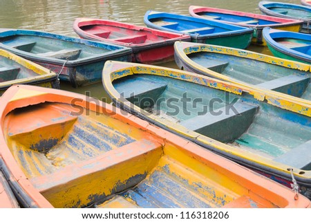 rows of colorful boats in park