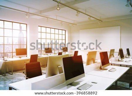 Rows of computers with black screens in office, big windows, white poster on wall. Toned, filter. Concept of work. Mock up. 3D rendering. - stock photo