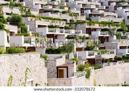 rows of condos and balconies - stock photo