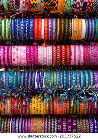 Rows of different color cloth bracelets on the market