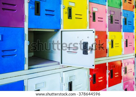 Rows of different colors metal lockers, select focus - stock photo
