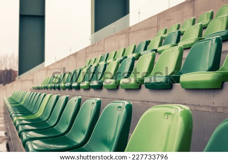 Rows of empty chairs in a stadium