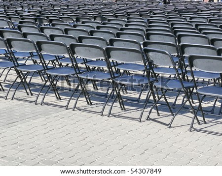 rows of empty chairs. More of this motif & more backgrounds in my port. - stock photo