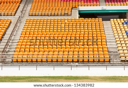 Rows of empty seat in stadium at National stadium Thailand. - stock photo