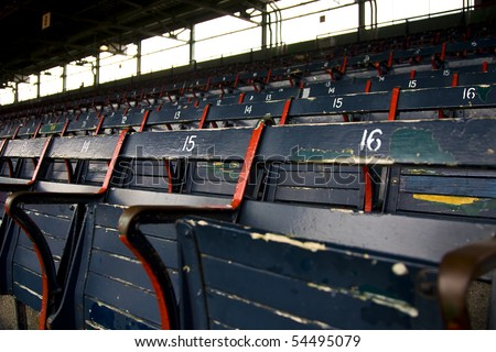 Rows of empty seats in a ballfield - stock photo