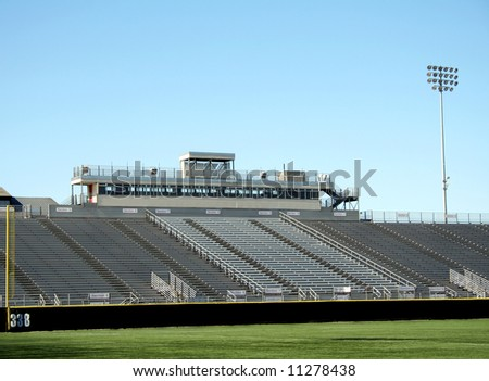 Rows of empty stadium bleachers at sports field