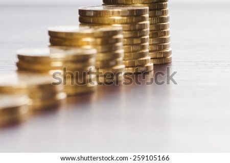 rows of gold stack coins