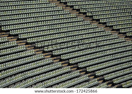 Rows of green seats in a stadium
