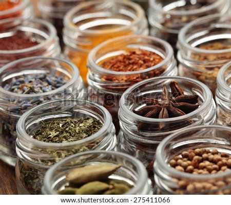 Rows of jars with various spices - stock photo