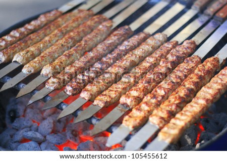 Rows of juicy beef kebab koobideh on grill