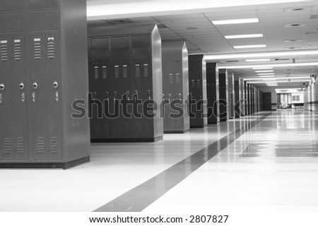 Rows of lockers in a modern high school; great for back to school usage