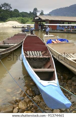 Rows of long boat at Taman Negara National Park, Malaysia - stock photo