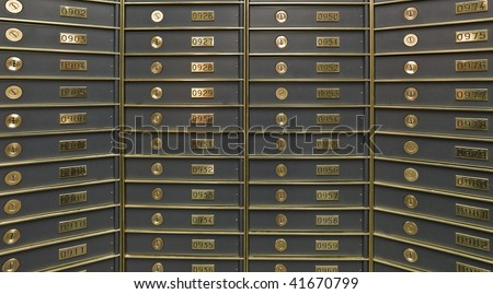 Rows of luxurious safe deposit boxes in a bank vault - stock photo