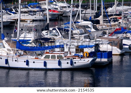 Rows of luxury yachts anchored in Boston harbor. Names and trademark are revomed. - stock photo