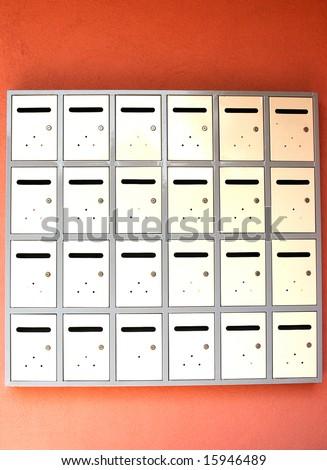 Rows of metallic mailboxes - stock photo