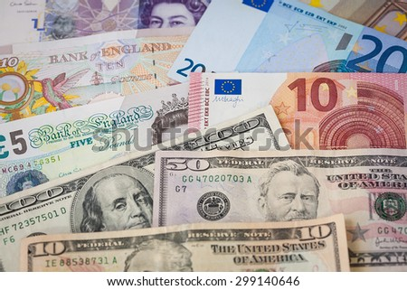 Rows of Mixed Currency Notes, Euros, British Pounds and American Dollars - stock photo