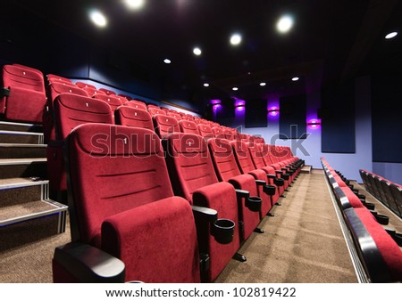 Rows of movie theater seats - stock photo