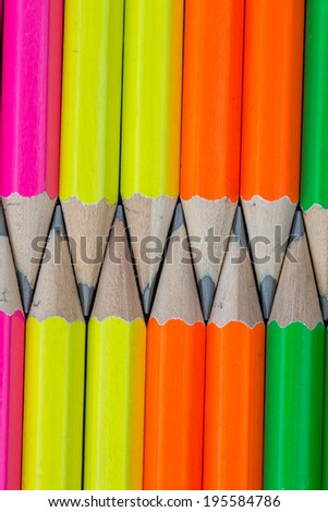 rows of neon colored pencils - stock photo