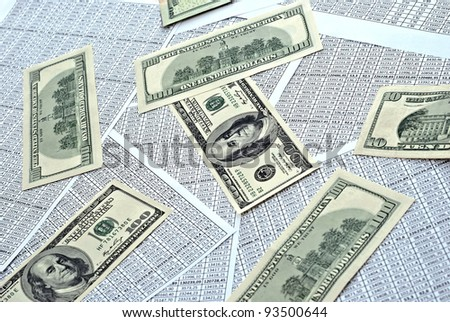 Rows of numbers on a spreadsheet and dollars - stock photo