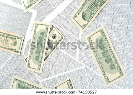 Rows of numbers on a spreadsheet and money - stock photo