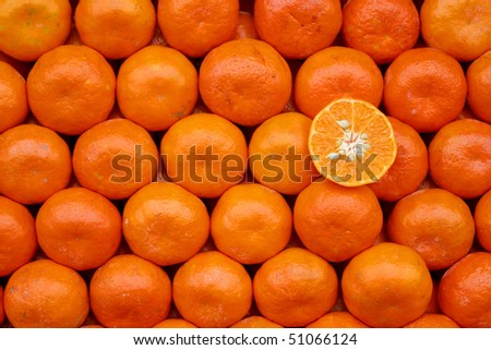 Rows of oranges at the market - stock photo