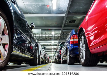 rows of parked cars on a ferry ship - stock photo