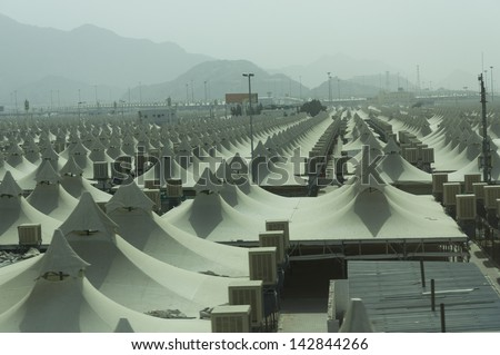 Rows of pilgrims tents in Mina, Saudi Arabia. These tents made of fire-proof materials house millions of pilgrims for three to five days during hajj period. - stock photo