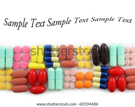 Rows of pills with space for text - stock photo
