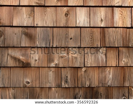 Rows of red cedar on an exterior wall weathered by exposure. - stock photo