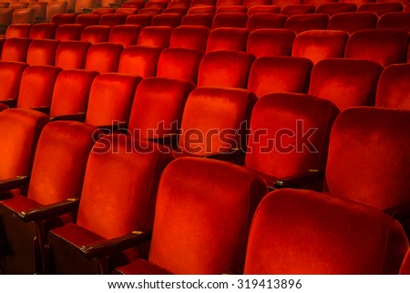 Rows of Red Chairs inside a theatre with copy space