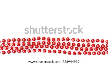 Rows of red christmas tinsel beads ornament isolated on white with copy space