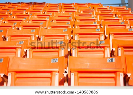 Rows of red football stadium seats - stock photo