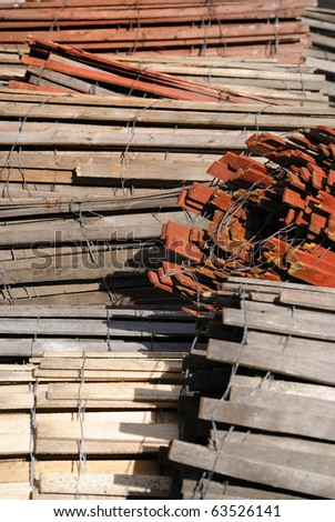 rows of rolled up wooden fencing - stock photo
