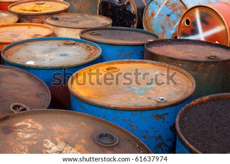 Rows of rusty barrels