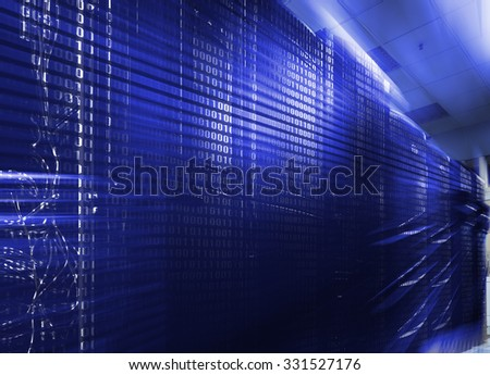 rows of server hardware with blue backlight - stock photo