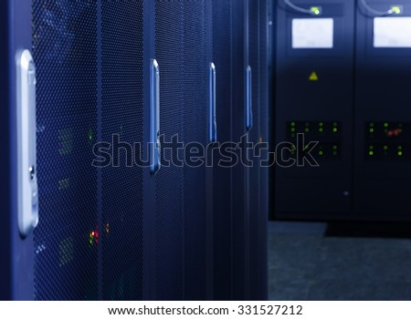 rows of servers in the data center blur - stock photo