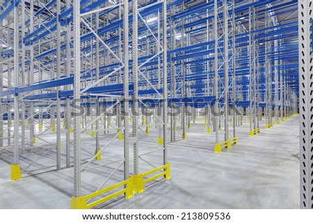Rows of shelves in new warehouse - stock photo