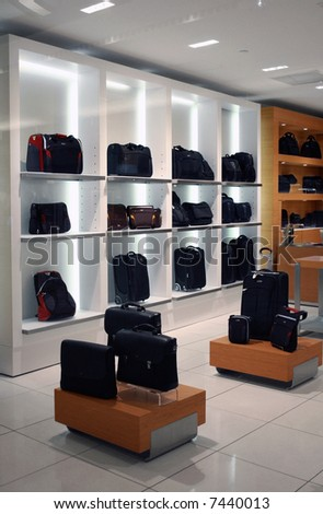 Rows of suitcases in a store at the airport - stock photo