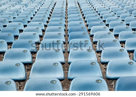 Rows of symmetrical seats in a stadium